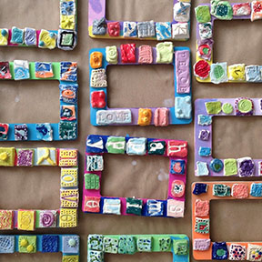 tile-decorated frames made by children